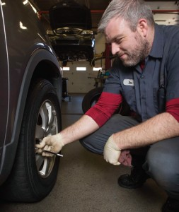 Ben Powell, a general service technician from Atlantic Tire and Service, checks tire pressure.